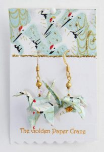 Paper crane earrings with flying cranes on celadon green