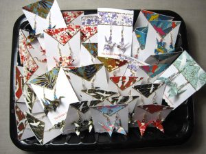 paper crane earrings ready to be sold