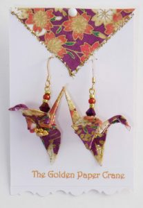 Paper Crane earrings flowers on maroon background
