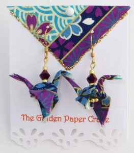 Paper Crane earrings on purple and turquoise