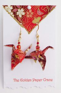 Paper Crane earrings on red washi paper