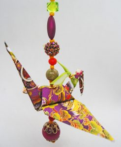 Paper Crane folded with purple, gold, and green Washi paper